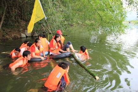 Team Five is getting across the river on the bamboo raft they made.