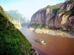 A boat sailing through the Three Gorges on the Yangtze